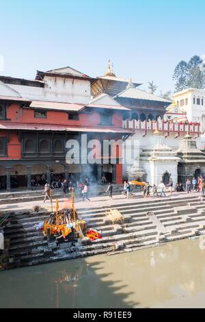 Cremation ghats at Pashupatinath Hindu temple complex, Kathmandu, Nepal - Stock Photo