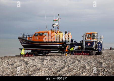 RNLI Shannon Class Lifeboat William F Yates is retrieved from the sea at Llandudno's North shore following sea exercises - Stock Photo