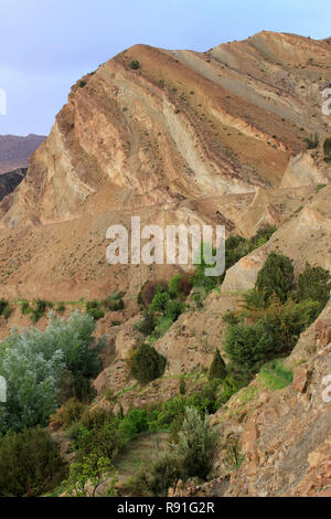 Weathered Sedimentary Rock Formations Tighza (Tijhza) Village, Ouarikt valley, High Atlas Mountains, Morocco - Stock Photo