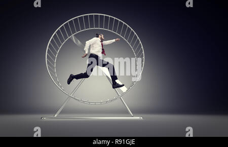 caucasian businessman run in abstract hamster wheele - Stock Photo