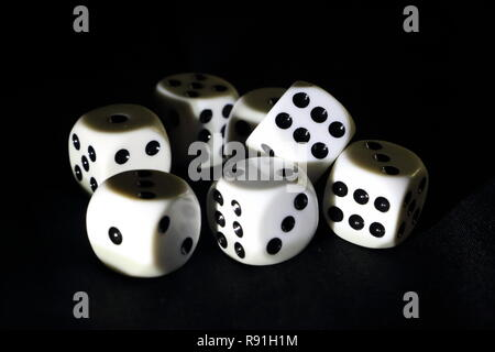 Dice for playing a game and win or lose your money - Stock Photo