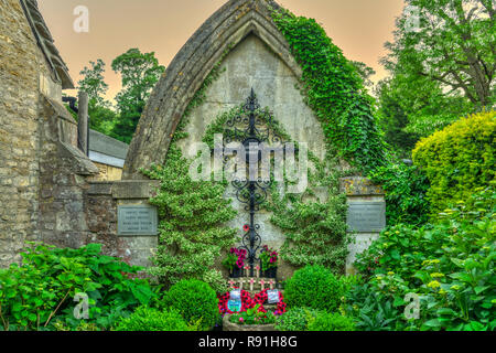 A war memorial cenotaph in the picturesque village of Castle Combe, Wiltshire, England, Europe. - Stock Photo