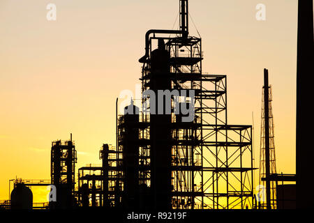 Silhouetted petrochemical works at sunset in Billingham on Teesside, England, UK - Stock Photo