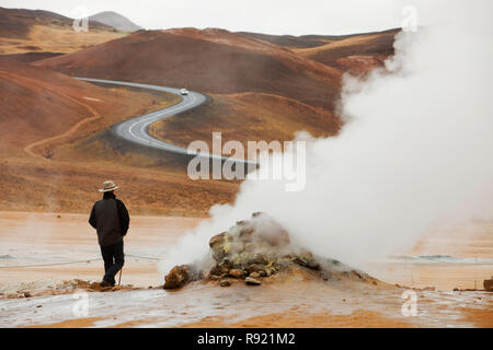 Fumaroles emitting steam in the geothermal area of Hverir near Myvatn, northern Iceland - Stock Photo