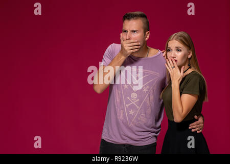 Unhappy discontent woman and man look with disgusting expression, as see something unpleasant. Awkward couple - Stock Photo