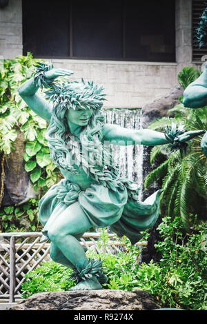 Waikiki, Hawaii - 25 May 2016: Close up image of a female statue outside the Hilton Hawaiian Village by commissioned artist Kim Duffet. Kaha Ka `Io Me - Stock Photo