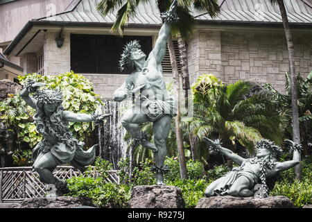 Waikiki, Hawaii - 25 May 2016: 'The Hawk Soars with the Winds' a trinity sculpture that depicts two females and one male performing the awe-inspiring  - Stock Photo