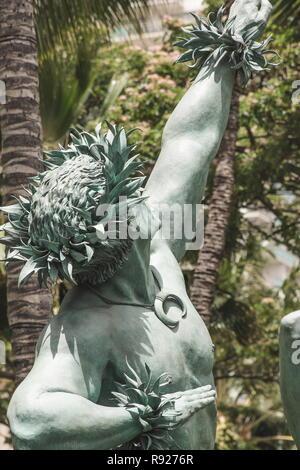 Waikiki, Hawaii - 25 May 2016: Close up image of the male statue outside the Hilton Hawaiian Village by commissioned artist Kim Duffet. Kaha Ka `Io Me - Stock Photo