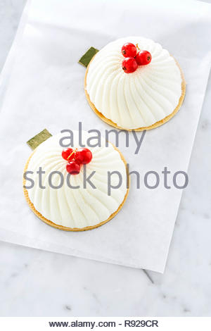 Pistachio biscuits with marzipan, raspberry coulis and mousse based on white French chocolate. - Stock Photo