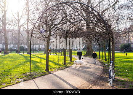 Russell Square, London, UK - February 2017. People in Russell Square, a large garden square in Bloomsbury, in the London Borough of Camden - Stock Photo