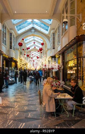 Shoppers walkling through the historic (1819) Burlington Arcade in Mayfair, central London, England, UK. - Stock Photo