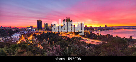 Perth, Australia. Perth skyline at sunrise with a view over the city and Swan River. Taken from Kings Park,  Western Australia - Stock Photo