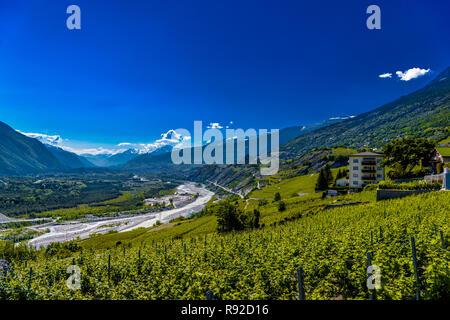 Vineyards and river in Swiss Alps mountains valley, Leuk, Visp, Wallis, Valais, Switzerland - Stock Photo