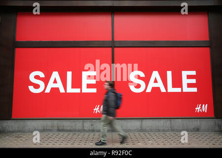 London, UK. 18th December, 2018. The crisis on Britain's high streets is to intensify this Christmas, with shopkeepers preparing themselves for the quietest festive period since the credit crunch, according to forecasts. Many stores around the country have taken to slashing their prices and starting their sales early such as these in Londons Oxford Street. Credit: Nigel Bowles/Alamy Live News - Stock Photo