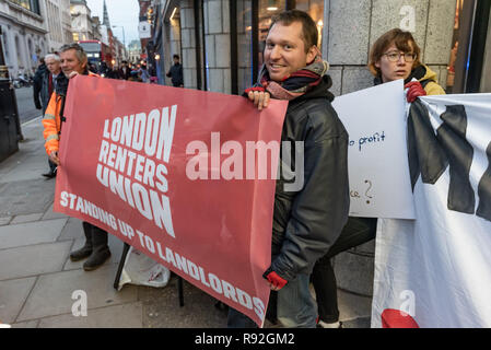 London, UK. 18th December 2018.  London Renters Union supporting the protest by Berlin community centre and pub Syndikat outside the London offices of their landlord, Global Real Estate Investors Limited, owned by the secretive Pears brothers, three of the richest men in the UK, who through various 'letterbox' companies own around 6200 properties in Berlin, against notice to quit  at the end of December. Credit: Peter Marshall/Alamy Live News - Stock Photo