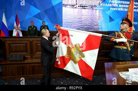 Moscow, Russia. 18th December, 2018. Russian President Vladimir Putin pins a regimental flag during a ceremony before meeting with military leadership at the Russian Defense Ministry headquarters December 18, 2018 in Moscow, Russia. Credit: Planetpix/Alamy Live News - Stock Photo