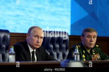 Moscow, Russia. 18th December, 2018. Russian President Vladimir Putin sits with Chief of the Russian Armed Forces, Gen. Valery Gerasimov, right, during a meeting with military leadership at the Russian Defense Ministry headquarters December 18, 2018 in Moscow, Russia. Credit: Planetpix/Alamy Live News - Stock Photo