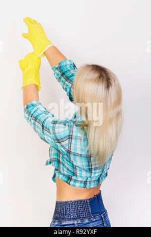 woman housekeeper wear yellow rubber gloves on white background back view - Stock Photo