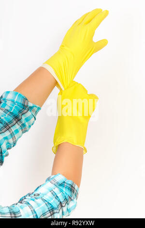 woman housekeeper wear yellow rubber gloves on white background - Stock Photo