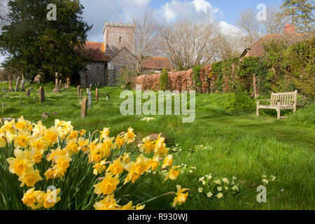All Saints flint church in East Dean, a village in the South Downs National Park near Chichester, West Sussex - Stock Photo