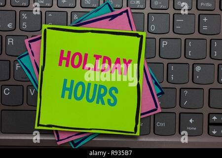 Handwriting text writing Holiday Hours. Concept meaning Schedule 24 or 7 Half Day Today Last Minute Late Closing Papers reminders keyboard Inspiration - Stock Photo