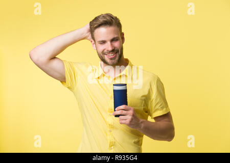 Man handsome bearded hipster hold plastic bottle shampoo or shower gel. Hair care concept. Effective shampoo. Try this shampoo. Best shampoo for your hair type. Make hair stronger and more resilient. - Stock Photo
