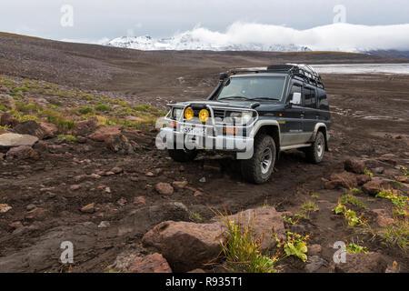 Extreme off-road expedition auto Toyota Land Cruiser Prado driving on mountain road - Stock Photo