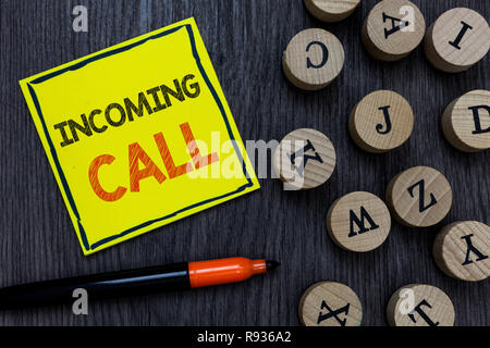 Conceptual hand writing showing Incoming Call. Business photo showcasing Inbound Received Caller ID Telephone Voicemail Vidcall Yellow paper circle Ma - Stock Photo