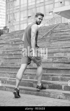 Man in active wear and sneakers on steps. Sportsman workout on stairs. Fit and confident. Future and success. Ready to overcome any obstacle. Sport and training activity. - Stock Photo