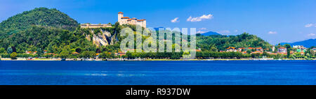 Famous Rocca di Angera,view with old castle and Lake Maggiore,Italy. - Stock Photo