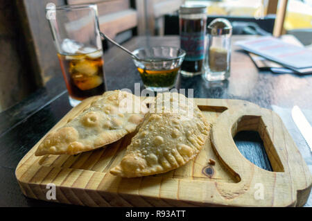 Mexican Food, Latin American, Traditional baked pastry Empanadas with meat - Stock Photo