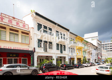 Long row of conserved shophouses located along Bukit Pasoh Road, Singapore - Stock Photo