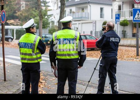 Policemen operating a laser speed gun, extensive speed controls in North Rhine-Westphalia on 24.10.2012, Recklinghausen - Stock Photo