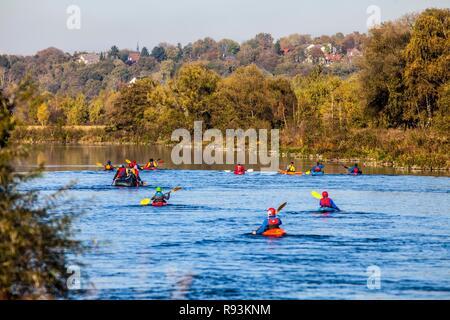 Canoeists on the Ruhr River in autumn, near Hattingen, North Rhine-Westphalia - Stock Photo