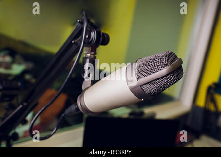 microphone on stand up comedy stage with reflectors ray, high contrast image - Stock Photo
