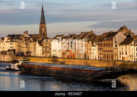 Eastern parts of the city on the Maas River, historic town centre, cargo ship, Maastricht, Limburg, The Netherlands - Stock Photo