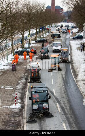 Street cleaning, municipal cleaning workers cleaning a street after a carnival parade, Essen, North Rhine-Westphalia, Germany - Stock Photo