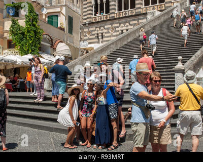 Amalfi, Italy - June 13, 2017: The center of the town of Amalfi on the Amalfi Coast of Italy with the stairs leading up to the famous Amalfi Cathedral - Stock Photo