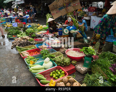 Fresh Fruit and vegetables laid out on the ground displayed for sale Can Tho  City outdoor market Vietnam Asia - Stock Photo
