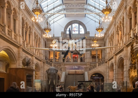 Glasgow, Scotland, UK - December 14, 2018: The suspended Spitfire aircraft within the Kelvingrove Museum in Glasgow which has been open since 1901 and - Stock Photo