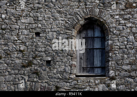 Old arched window in a stone building, St David's cathedral, Pembrokeshire, Wales, UK - Stock Photo