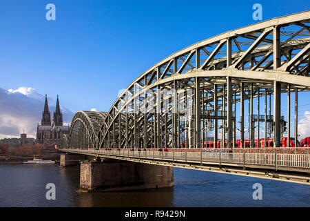 the cathedral and the Hohenzollern bridge over the river Rhine, Cologne, Germany.  der Dom und die Hohenzollernbruecke ueber den Rhein, Koeln, Deutsch - Stock Photo