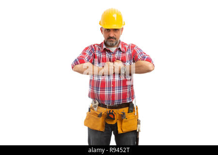 Builder pushing chest with fists having serious expression isolated on white background - Stock Photo