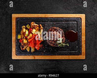 Matured Argentinian ribeye steak with grilled vegetables and barbecue sauce with coke - Stock Photo