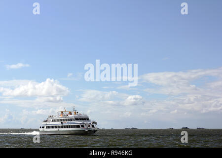 The ferry on the way to Hallig Groede in the North sea - Stock Photo