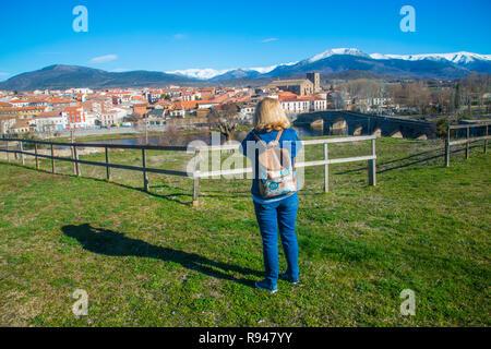 Woman taking photos of the village. El Barco de Avila, Avila province, Castilla Leon, Spain. - Stock Photo