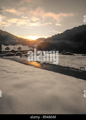 Fantastic evening winter landscape glowing by sunlight. Dramatic wintry scene during sunset in lower Austria - Stock Photo