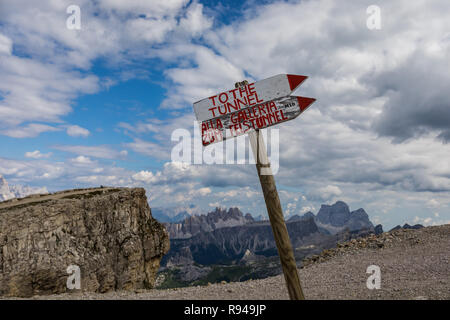 Sign with directions to the tunnel, dug into the Lagazuoi Mountain during the First World War and to Galleria of the Piccolo Lagazuoi, Dolomites,Italy - Stock Photo