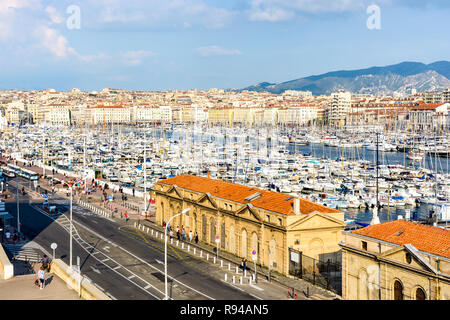 View over the Old Port of Marseille, France, with motorboats and sailboats moored in the marina at sunset. - Stock Photo