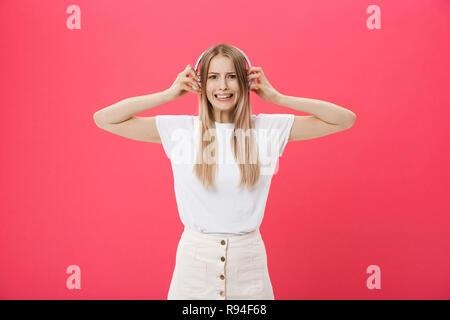 Young woman operator from call center covering ears ignoring annoying loud noise, plugs ears to avoid hearing sound. Noisy music is a problem - Stock Photo
